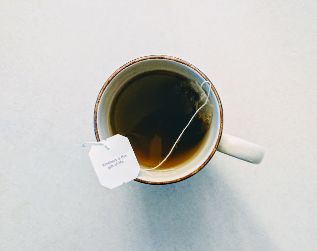 beautiful cup of freshly made tea with a tea bag and wish