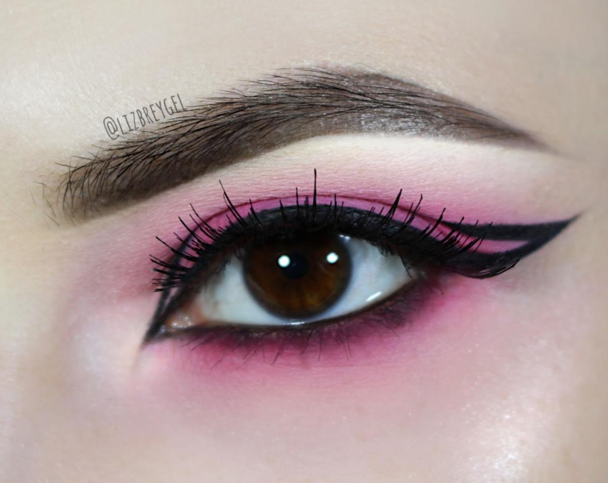 bubblegum pink and graphic eyeliner makeup look on brown eyes