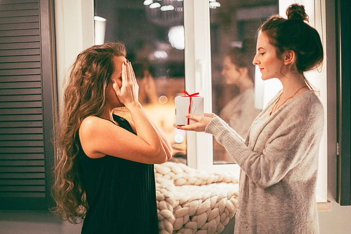 girl is giving present to her friend